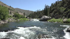 Wide-angle, slow motion shot of a section of rapids on the Truckee river - stock footage