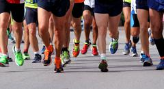 runners to race to the finish line of the marathon - stock photo