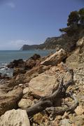 Spain, Balearic Islands, Ibiza, Cala Es Cubells, Meditteranean Sea Stock Photos