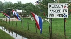 Roadside fruit market + billboard and dutch flag Stock Footage