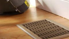 Worker uses spray to clean vent cover - stock footage