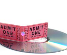 ticket stub and dvd on white, entertainment concept - stock photo
