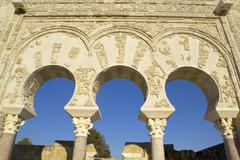 columns and arches of yar'far facade. medina azahara. cordoba. - stock photo