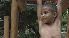 Cute Brazilian boy exercise on park background Stock Footage