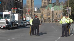 Officers speak in front of parliament hill, ottawa, WS Stock Footage