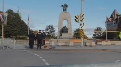 Police Officers by war memorial, Ottawa Stock Footage
