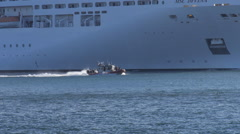 US Coast Guard  machine gun armed escort patrol boat 1 60p Stock Footage