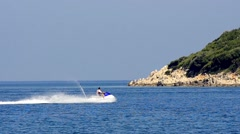 Tracking a sport man fast driving on a jet ski motor Stock Footage