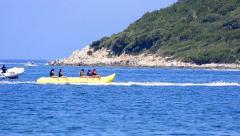 Water banana ride summer leisure joy Stock Footage