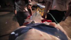 Rescuing injured on stretcher Stock Footage
