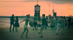 Couples dancing on pier Stock Footage