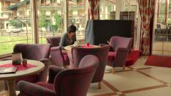 Woman in bar of elegant hotel - stock footage