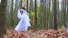 Beautiful girl dressed as forest fairy Stock Footage