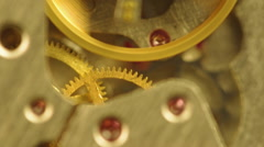 Stock Video Footage of Background with metal cogwheels a clockwork in old watch.