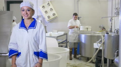 workers inside typical italian dairy  factory: cheese, milk, farm, farmer - stock footage