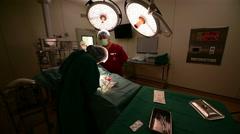 veterinarian doctor in operation room - stock footage