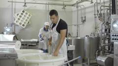 People Making Cheese In Factory: italian food factory, mozzarella, ricotta, milk - stock footage