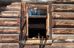 open window in the old rural wooden house - stock photo
