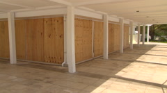 Hurricane Warning boarded up shutters Stock Footage