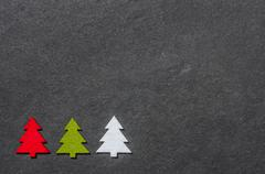 slate board with three felt christmas trees - stock photo