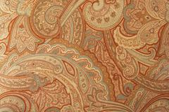 A brown paisley 70s style design pattern Stock Photos