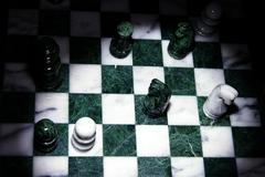 assorted chess pieces arranged on the board - stock photo