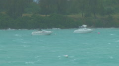 Moored boats rock in wind as hurricane approaches Stock Footage