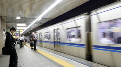 Time Lapse of Train Entering Subway Station at Busy Tokyo Metrorail System Stock Footage