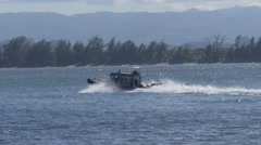Police patrol boat at full speed Stock Footage