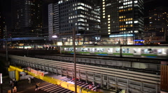 Time Lapse of Train Passing over Bridge in Central Tokyo Japan at Night Stock Footage