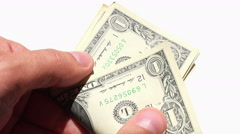Close up on hand counting dollar bills Stock Footage