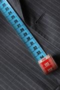 Measure tape and classic gray coat - stock photo