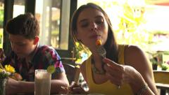 Woman and boy eating meal in restaurant in the city HD Stock Footage