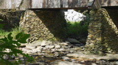 Rock pillars of historic covered bridge - stock footage