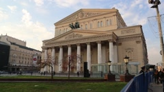 Pedestrian Walks Along the Blue Fence in Front of the Bolshoi Theatre in Moscow Stock Footage