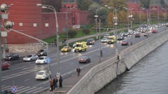Ambulances with Lights and Sirens Pass in Front of Red Square Stock Footage
