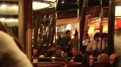 Multiple Mirrors Reflect People Having Fun in Bar/Restaurant Stock Footage