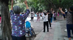 Shenzhen, China: women in jump square dance Stock Footage