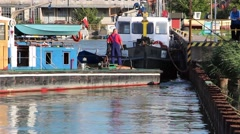 Small tugboat mooring in to the harbor 2 - stock footage