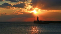 Stock Video Footage of Sunrise against a beacon in Yalta, the Crimea