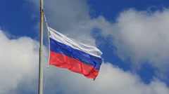 Russian national flag waving on flagpole in blue sky. Russia Stock Footage