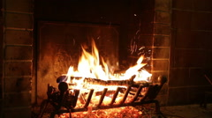 In an ancient stone fireplace fire burns Stock Footage
