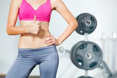 Closeup of young slim woman with six-pack torso. Stock Photos
