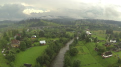 Rural mountain areas with  village in cloudy day .Aerial  Stock Footage