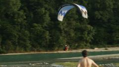 0487  Motorized paraglider flying over the waters of river Piave in Italy Stock Footage