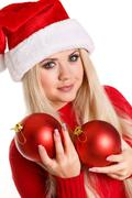 Maiden with Christmas balls in the hands of Stock Photos