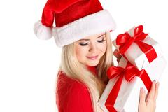 Beautiful Snow Maiden with gifts in the New Year's Eve Stock Photos