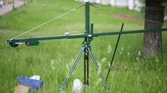 Homemade crane for camera shooting outdoors on green grass Stock Footage