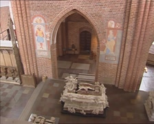 ROSKILDE CATHEDRAL  pan stone covered niche in pillar with tombs + sarcophagi Stock Footage