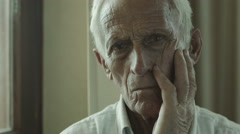 sad old man sitting alone: sadness, loneliness, thoughts, thoughtful, depression - stock footage